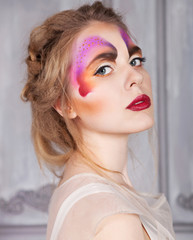 Model beautiful woman with perfect butterfly make up and hairsty