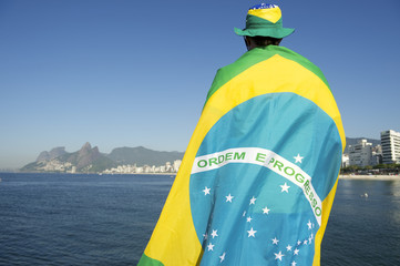 Brazilian Wrapped in Flag at the Sea