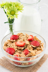 Morning breakfast with cornflakes and fresh stawberry
