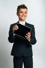 boy  showing tablet computer