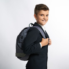 happy schoolboy with schoolbags