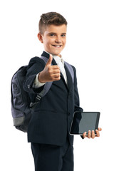 student holding a tablet and showing thumbs up