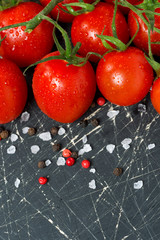 dark wooden background with cherry tomatoes