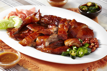 close up chinese duck and sauce in white dish