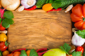 wooden board for recipe, spices and fresh vegetables