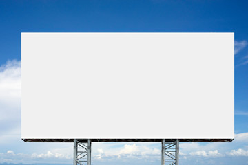 Empty billboard in front of cloudy sky