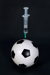 Soccer ball and syringe