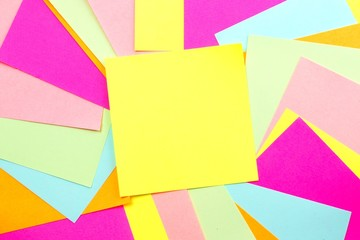 Blank yellow post it note with colorful note background