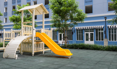 Combination playground structure of slide, climber and playhouse