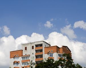 White clouds over a house