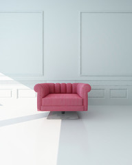 Single pink armchair in a white paneled room