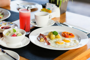 Fried eggs, fruit salad and fresh watermelon juice