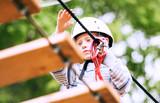 Boy practicing air track  at adrenalin park poster