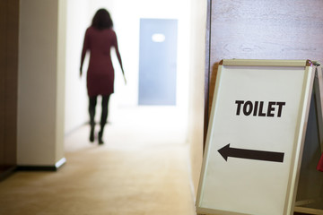 woman going to toilet