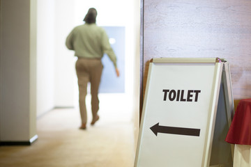 man going to toilet