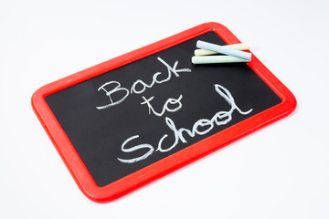 Back to school, blackboard and chalks.