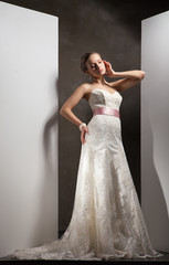 The beautiful young woman in a wedding dress