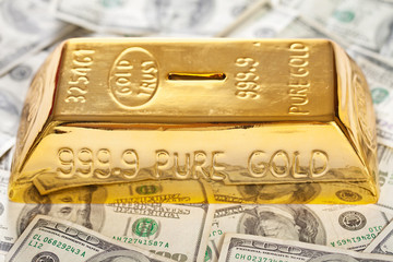 Gold bullion like moneybox