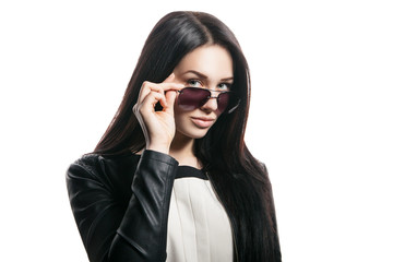 Woman in sunglasses posing on white background
