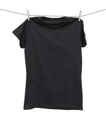 black t-shirt hanging on clothesline