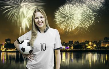 German woman soccer fan holding a soccer ball