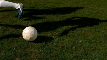 Football player controlling the ball on pitch