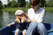 Mother with son in the boat