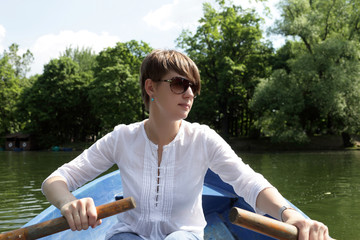 Rowing girl in a boat