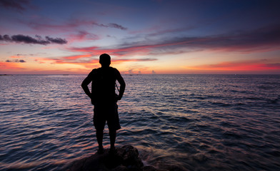 Silhouette of a single man watching the sunset