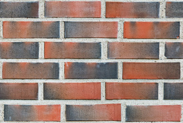 Burned red lining brick wall seamless background
