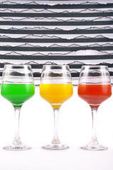 Colored glasses with drinks