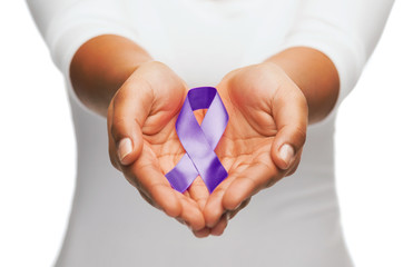 hands holding purple awareness ribbon