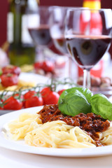 pasta bolognese with basil and wine