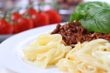 pasta bolognese with basil