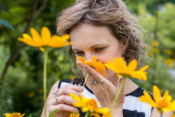 girl in the garden with yellow daisies