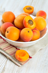 apricots in a bowl on wooden table