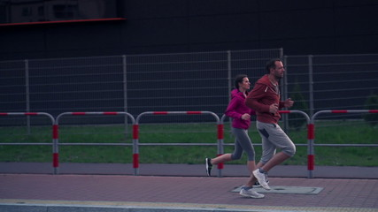 Couple jogging in the city, super slow motion, shot at 240fps
