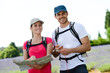 Happy young couple trekking together summer vacation countryside