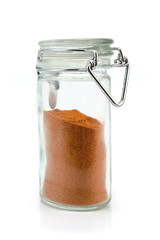 Red pepper powder in jar isolated on white