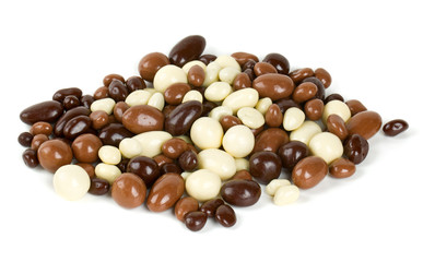 chocolate covered nuts and raisins isolated on white