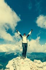 Female climber celebrating a successful ascend
