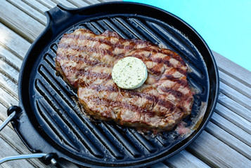 bbq a grilled steak at  the swimming pool