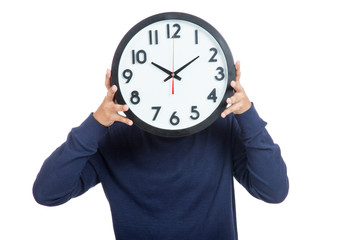 Asian man close his face with  a clock