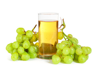 Grape bunch and glass of juice isolated on white