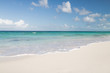 Leinwanddruck Bild - blue sea or ocean, white sand and sky with clouds