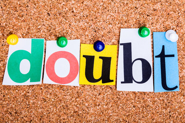 The word DOUBT on a bulletin board
