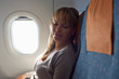 people travelling relaxed woman sleeping on plane