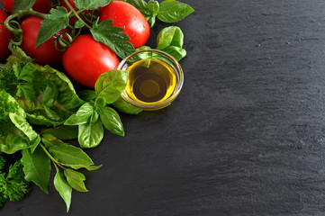 tomatoes and fresh basil leaves with olive oil