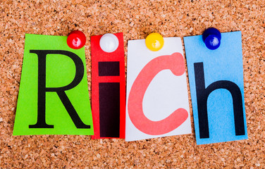 The word RICH on a bulletin board