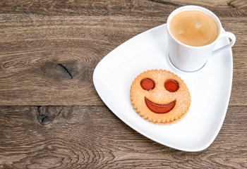 coffee with smiled cookie. funny breakfast